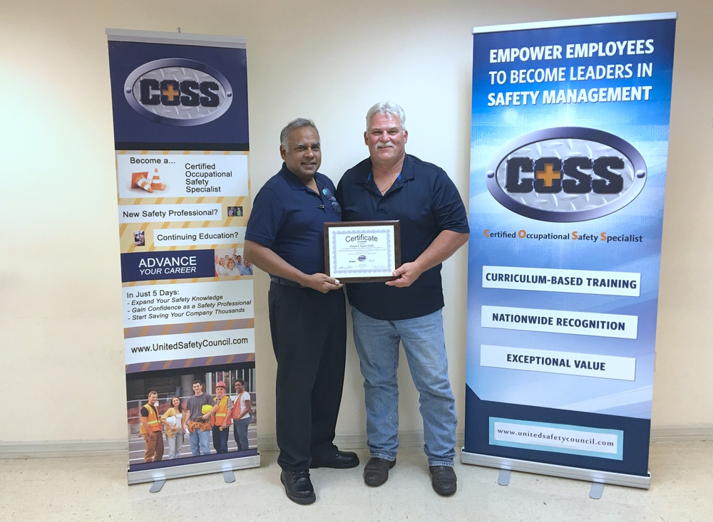 Bhushan Sukhram, Safety Supervisor for the City of Orlando and Central Florida Safety Council COSS Program Instructor, presents Robert Keyes, PAT Operations Support, his Occupational Safety Specialist certificate.