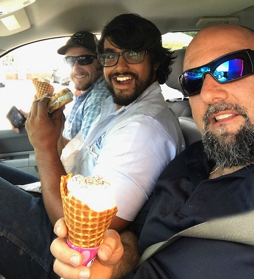 USST crew members Aaron Hood, Matt Hughes and Paul Del Favero take an ice cream break