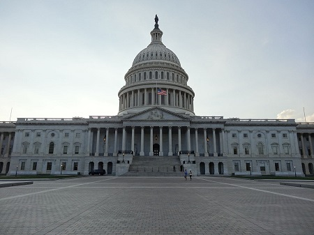 Front shot of the US Capitol building on a clear, cloudless day, home of United States Congress.