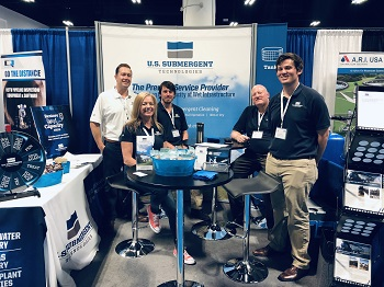 5 USST team members in company booth at the Florida Water Resources Conference in Tampa, Florida.