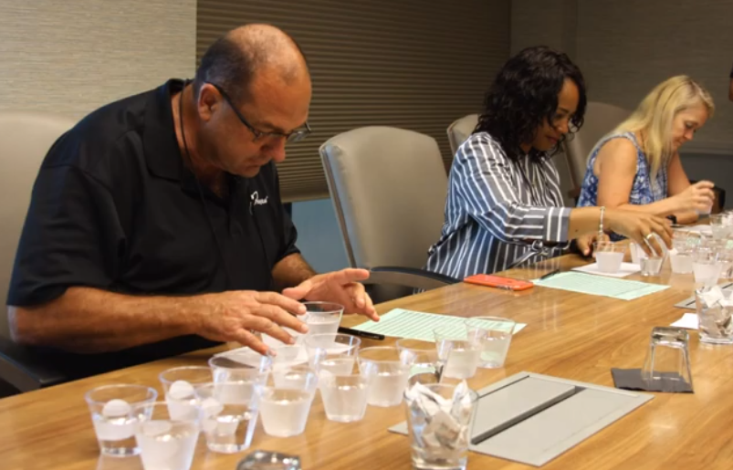 Judges examining water samples at the 2019 Best Tasting Water Contest.