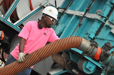 USST equipment operator wearing pink for Breast Cancer Awareness Month.