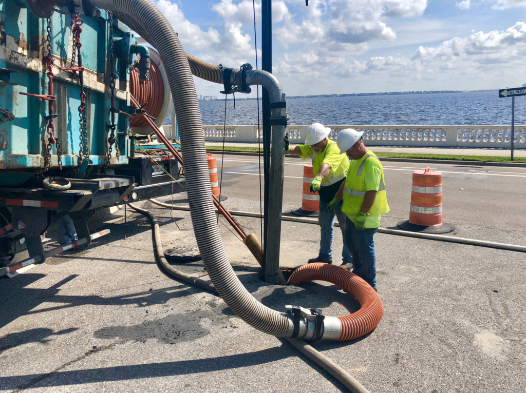 U.S. Submergent Technologies crew cleaning large diameter pipe in Tampa, Florida