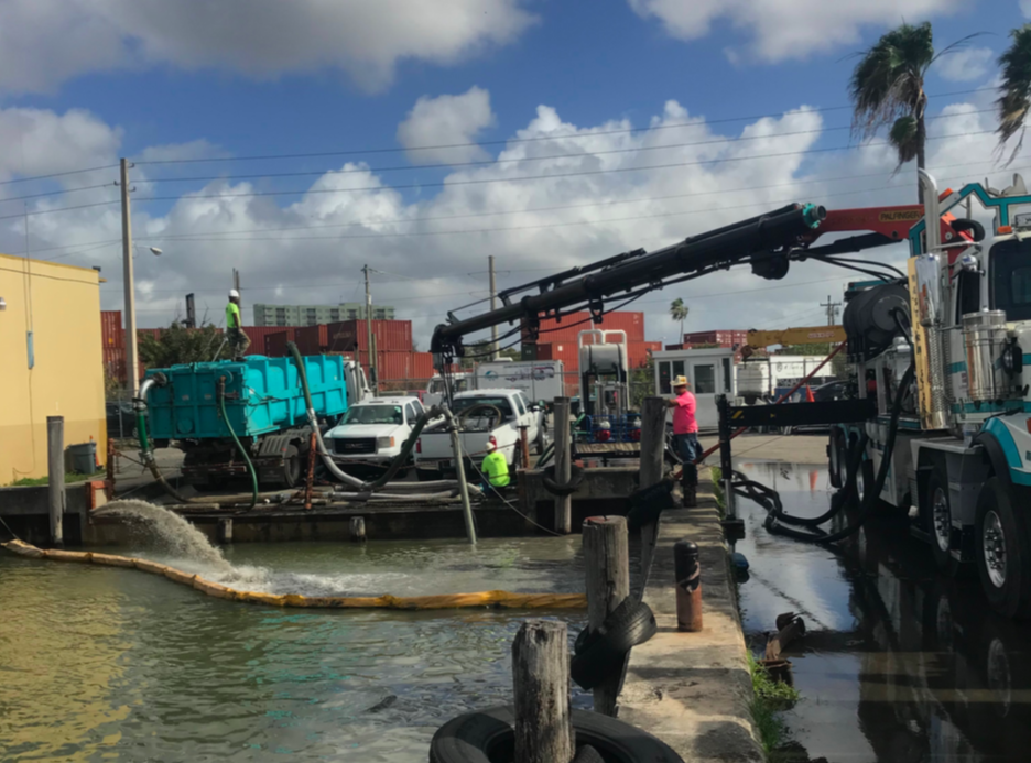 Miami-Dade, FL -  Capacity Restored to Blocked Stormwater Pipe 32-Tons of Sand Removed in Surcharged Conditions